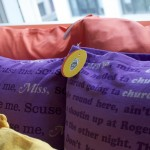 Detail of tags and pillows from The Space Between (Copyright © 2012 Ashley D. Hairston)